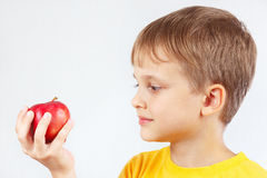 Little boy in yellow shirt with red apple. Little boy in a yellow shirt with red apple royalty free stock photos