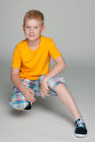 Little boy in the yellow shirt Royalty Free Stock Photo