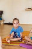Little boy on a yoga class Stock Photos