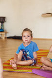 Little boy on a yoga class Stock Image