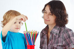 Little boy with young mother with color pencils Stock Photos