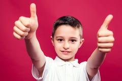 Little Boy z aprobatami Zdjęcie Stock