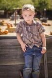 Little Boy Z rękami w Jego kieszeniach przy Dyniową łatą Obraz Royalty Free