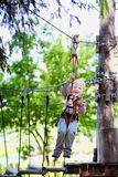 Little boy ziplining Royalty Free Stock Image