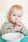 Little boyl eats royalty free stock image