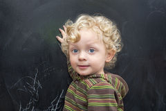 Little  boyl  at the old black school board Stock Photography