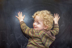 Little  boyl  at the old black school board Royalty Free Stock Photo