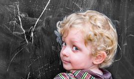 Little  boyl  at the old black school board Royalty Free Stock Photography