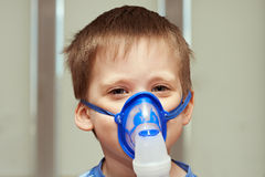 Little boyl using an inhaler Stock Photo