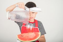 Little boys blend water melone juice by using blender home royalty free stock photo