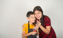 Little boys blend water melone juice by using blender home stock photos