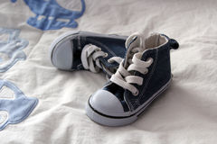 Blue denim baby shoes Royalty Free Stock Photos