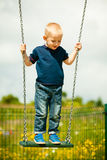Little boys brothers having fun on a swing outdoor Royalty Free Stock Images