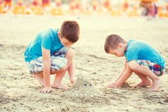 Little boys build sand fortress Royalty Free Stock Image