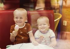 Little boys in cafe Royalty Free Stock Image