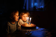Little boys celebrating  birthday and blowing candles on homemad Royalty Free Stock Photography