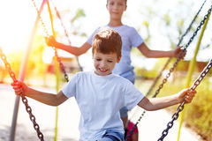 Little boys climbing on jungle gym outdoor Royalty Free Stock Image