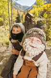 Little boys with crocheted beards in mountains Royalty Free Stock Image