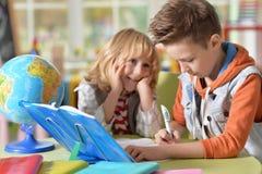 Little boys doing lessons Stock Photo