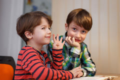 Little boys doing math exercise Royalty Free Stock Images