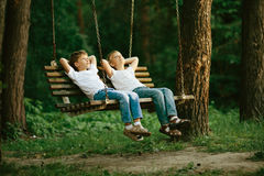 Free Little Boys Dreaming On Swing Stock Photography - 57494322