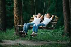 Little boys dreaming on swing Royalty Free Stock Photos