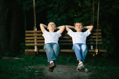 Little boys dreaming on swing Royalty Free Stock Images