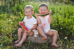 Little boys eating watermelon outdoors Royalty Free Stock Photos