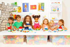 Little boys and girls constructing toy houses Stock Photography