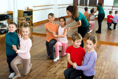 Little boys and girls having dancing Stock Photos