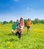 Little boys and girls running Stock Images