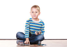 Little boys have fun and play cards. Stock Images