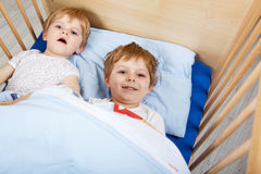 Two Little Toddler Boys Having Fun And Fighting In Bed At Home Royalty Free Stock Image