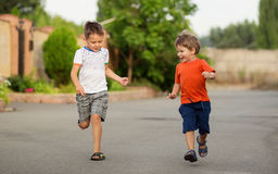 Little boys having fun while running Royalty Free Stock Photo
