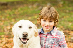 Little boys with his dog Stock Images