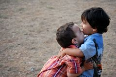 Little boys hugging. Cute, Little boys hugging each other and smiling Royalty Free Stock Photos