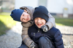 Little boys in knit cap have fun at winter Stock Image