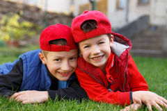 Little boys laughing in grass Stock Photo