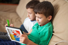 Little boys learn counting on abacus at home Royalty Free Stock Photos
