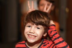 Little boys make mischief and showing donkey ears Stock Photo