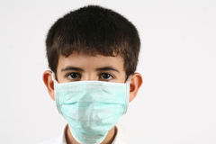 Little boys and a mask Royalty Free Stock Images