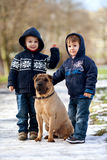 Little boys in the park with their dog friend. Standing Royalty Free Stock Photos