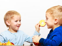 Little boys peeling apple cooking at home. Stock Photo