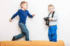 Little boys play with camera. Royalty Free Stock Photography