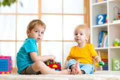 Little boys play together with educational toys Stock Images