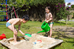 Little boys playing in the garden Royalty Free Stock Images