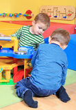 Little boys playing in kindergarten stock photos