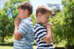 Little boys praying in the park Royalty Free Stock Photography
