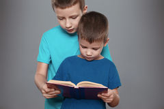 Little boys reading interesting book. Education Stock Image