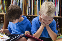 Little Boys Reading Picture Books Stock Image